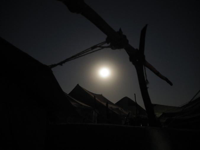 Full moon between the tents
