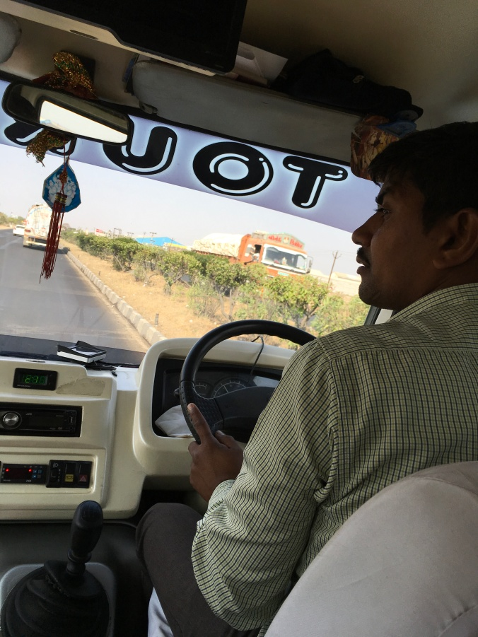 Our talented driver, Gajendra at the wheel of our comfy private coach.